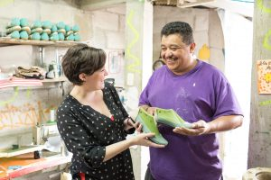 Bethany Tran with shoe maker, Otto